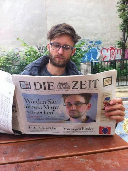 Edward Snowden reading a newspaper about...Edward Snowden.