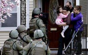 Photo: Massachusetts police search a home after the Boston bombings.